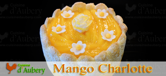 A typical layer cake called Charlotte, with an exotic twist and Mangoes, Coconut and Rum flavors